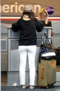 Tiffani Thiessen - booty in jeans at JFK Airport in NY 06/26/12